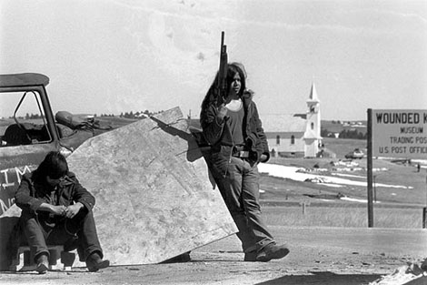 An American Indian Movement (AIM) guard posted at a roadblock outside Wounded Knee, South Dakota, in February 1973.