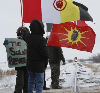 Protesters on the CN rail tracks that cross the Yellowhead Highway west of Portage la Prairie