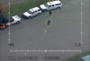 This still image from video taken by the RCMP's high altitude surveillance plane is the best image police have of the two people allegedly responsible for burning a marked RCMP SUV and an RCMP truck on Oct. 17, 2013. (RCMP surveillance photo)