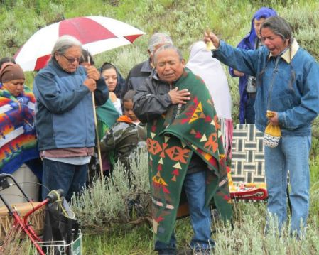 "Gerald Lewis of the Yakama Tribe, at left, and Armand Minthorn of the Umatilla Tribe sing during the ceremony honoring the child's reburial. Although it rained, Sister Clissene Lewis of the Yavapai Nation in Arizona said, ""It is a sign of renewal for all of us. We are one heart, one mind, one spirit."
