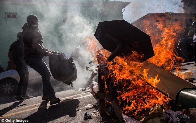 Burning: Demonstrators from Black Bloc clash with police and create a barrier of fire in Sao Paulo