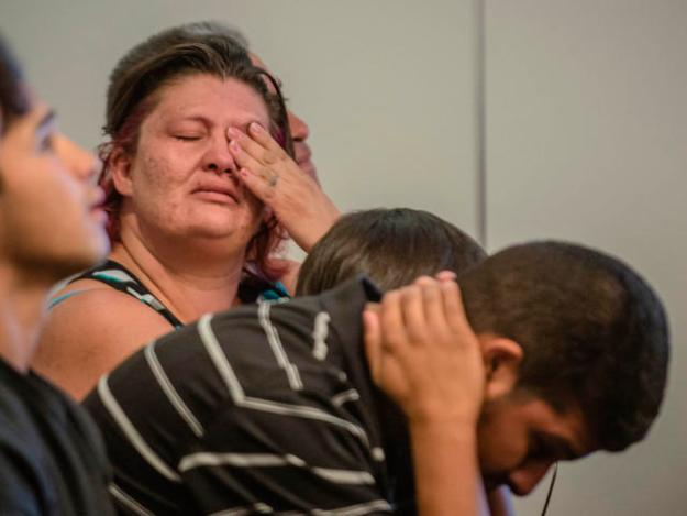 Family members of one of the teenagers accused of beating a homeless man to death react as Metro Court Judge Linda Rogers set the bond at $5 million on Monday afternoon. (Roberto E. Rosales/Albuquerque Journal)