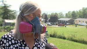 For the past couple of years Wendy Kearley says she hasn't been able to step outside without this mask. (CBC)