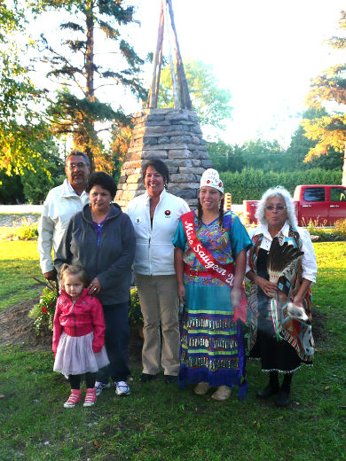 A stone and wood memorial monument dedicated to missing and murdered Aboriginal women was unveiled at the fifth annual Sisters in Spirit/Take Back the Night vigil Sept. 18 at Saugeen First Nation. On hand were, from left: Chief Vernon Roote, Cheryl George, Laurie Odjick, Miss Saugeen Aspen Chapman,and Shirley John. Front:Isabella Lees.