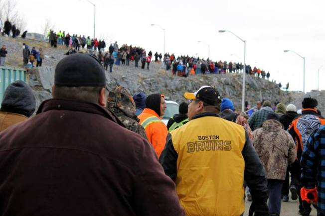 Women watch and support their warriors as they confront dam and rcmp. Tyler Adam Turcotte\Twitter