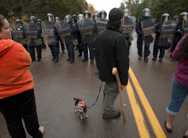 The protest on Route 134 near Rexton on Oct. 17, 2013, turned violent when police moved in to enforce a court injunction that prohibited protesters from interfering with the seismic exploration work. (Andrew Vaughan/Canadian Press)