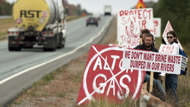 Protesters show their opposition to the construction of a natural gas STORAGE FACILITY near Stewiacke, N.S. on Wednesday, Oct. 1, 2014. (Andrew Vaughan / THE CANADIAN PRESS) Read more: http://www.ctvnews.ca/canada/first-nations-residents-slow-traffic-on-nova-scotia-highway-to-protest-gas-project-1.2033440#ixzz3EyW0Yaev