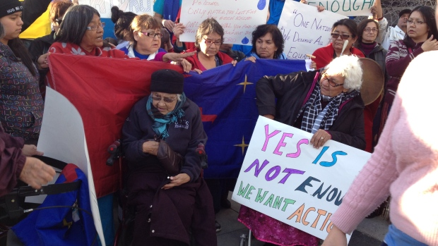 Protesters with the Pimicikamak Cree Nation rally outside Manitoba Hydro's headquarters in downtown Winnipeg on Oct. 23. (Marjorie Dowhos/CBC)