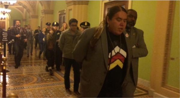 Pic: Protesters are taken away from the Senate chamber after chanting from the gallery following the Keystone vote. Frank Thorp VVerified/Twitter