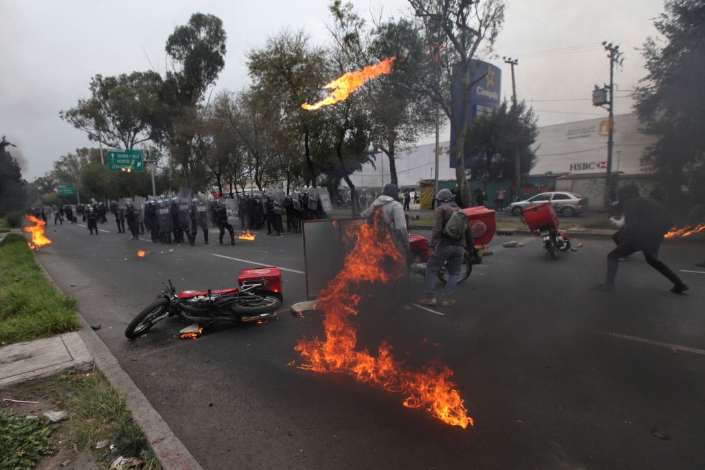 Molotov cocktails, clashes as thousands of Mexicans protest over massacre (Video)