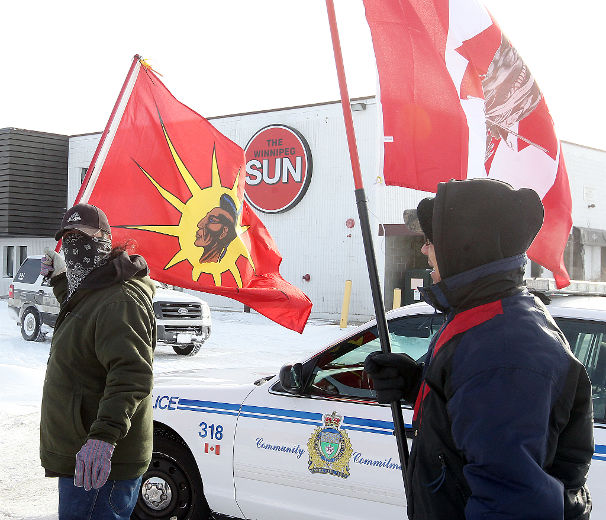 Aboriginal protesters demonstrate outside the offices of the Winnipeg Sun in Winnipeg, Man. Saturday Jan. 12, 2013.