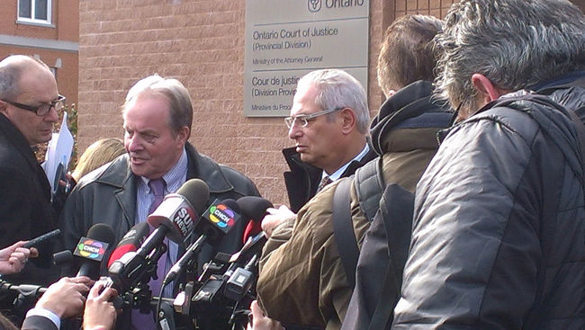 Andrew Koster, executive director of Brant Family and Children's Services, and Mark Handelman, council for the agency, discuss Friday's court decision regarding the care of a Six Nations girl with leukemia outside Ontario Court in Brantford.