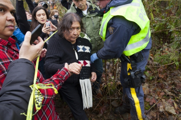 Elder Amy George crosses the police line into the police-protected Kinder Morgan work site. Photos by Mychaylo Prystupa.