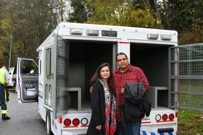 Rueben George and Melina Laboucan-Massimo of Greenpeace Canada awaiting Amy George on Ridgeview Drive. Photo by Peter Morelli.