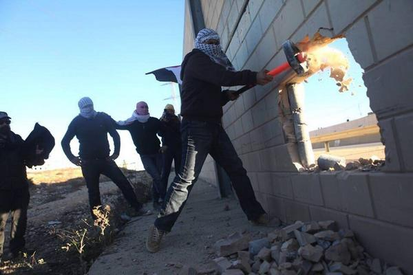 Palestinians break open illegal apartheid wall