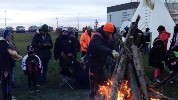 Protesters set up around a campfire near the Jenpeg generating station in October as part of their occupation at the site. (Pimicikamak Occupation of Jenpeg/Facebook)