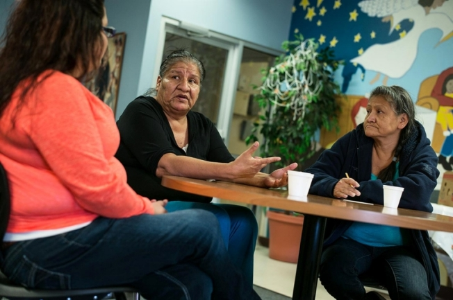 Alexis Tiyona, center, meets with grandmother Tanya Hill, right, and legal advisor Rosanna Schoneman at the Good Shepard Ministry in Sioux Falls, South Dakota on Oct. 22, 2014. Hill was successful in getting custody of three of her eldest daughter's children and six of her son's children. Andy Richter for Al Jazeera America
