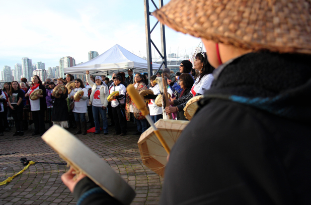 People attending the #AmINext rally calling for a federal inquiry into murdered and missing aboriginal women take part in a drum circle in Vancouver on Sunday, Dec. 7, 2014.