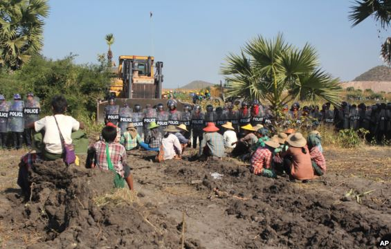 According to activists and opposition lawmakers, a woman was fatally shot Monday during a crackdown on protesters at the controversial Chinese-backed copper mine near Monywa in northwestern Myanmar, Dec. 22, 2014.