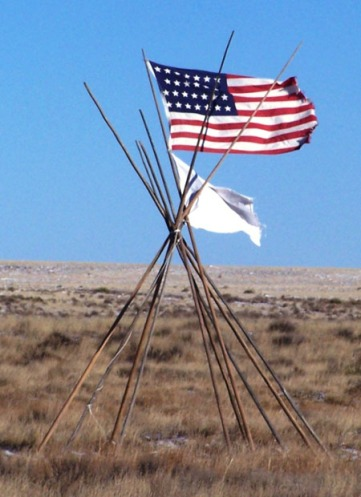 The American flag and the white flag flown by Cheyenne Chief Black Kettle at the time of Col. Chivington's attack were intended to show the peaceful nature of the encampment. Soldiers ignored these symbols.