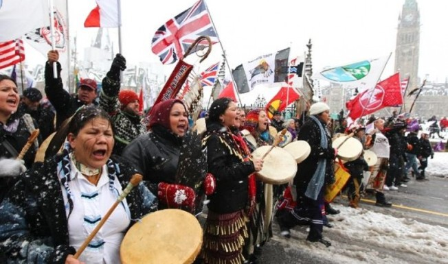 "Image of a 2012 ""Idle No More"" protest, via YouTube."