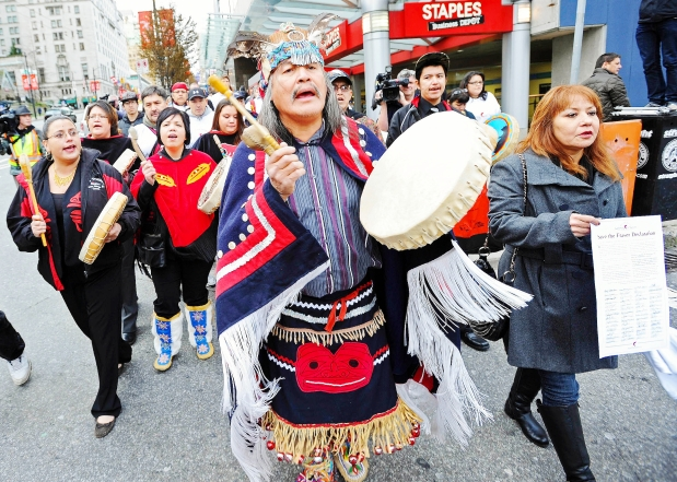 First Nations protesters demonstrate against the Northern Gateway pipeline outside the Vancouver offices of oil giant Enbridge in 2012.