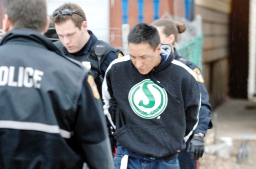 Members of the Regina Police Service take 32-year-old Anthony Joseph Slippery into custody. Photograph by: TROY FLEECE , REGINA LEADER-POST