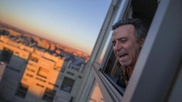 A member of the Victims' Mortgage Platform (PAH) shouts during Cecilia Paredes' eviction in Madrid, Spain, Friday, Jan. 23, 2015.