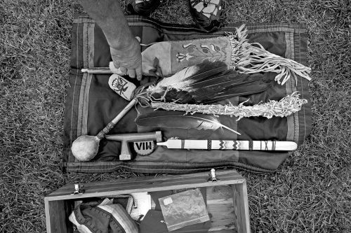 "Religious items that Bellecourt carries include eagle feathers, a rattle and a sacred pipe created just for him with the letters ""AIM"""