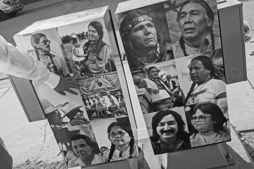 Images of AIM leaders are posted on the side of a utility box, part of a community art project to showcase Native American culture. Among those pictured are Bellecourt, left box, top left; Dennis Banks, an activist and co-founder of AIM, right box, top left; and Leonard Peltier, convicted in the shooting deaths of two FBI agents at Wounded Knee in a controversial trial that is still disputed, right box, bottom left.