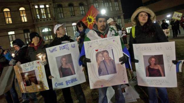 James Saunders, second from right, brother of missing Saint Mary's University student Loretta Saunders, attends a candlelight vigil at the Grand Parade in Halifax on Feb. 25. The body of the Inuit honours student was found a day later in the median of the Trans-Canada Highway near Moncton. A couple to whom she sublet her apartment are charged with her murder. (TIM KROCHAK/Staff)