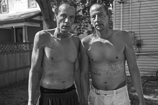 "The twins pose in Gerald's back yard in Minneapolis. ""We never fought one on one,'' said James, right. ""We made sure people knew if you messed with one Cross, the other one was coming.'' (Click to enlarge images)"