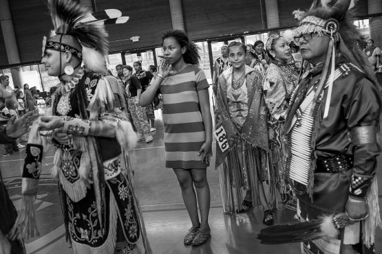Bearstops prepares to dance at a community powwow.