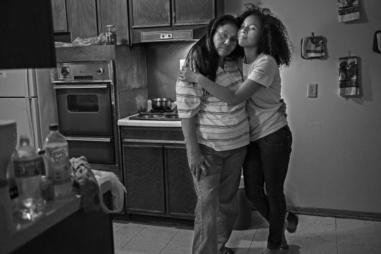 Bearstops with her mother Reva in their kitchen.