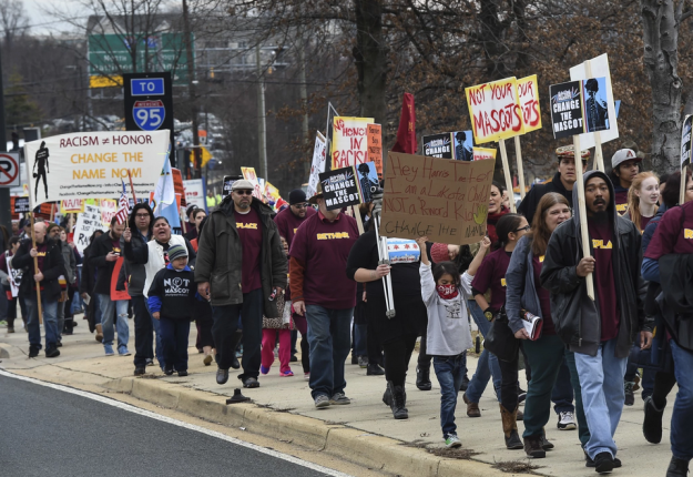 Native Americans and supporters protesting the name and logo of the Washington Redskins are seen before the game on Dec. 28 near FedEx Field. (Toni L. Sandys/The Washington Post)