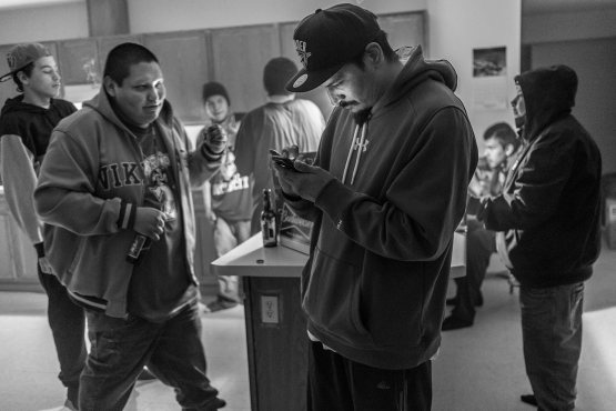 """Senister checks his cell phone. """"Nobody cares about us Natives,'' Senister says. """"How we eat. How we live. They don't care. We gotta look out for each other.''"""