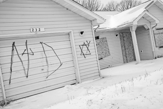Dell said he was unable to finish the Native Disciples graffiti on this abandoned house because he ran out of spray paint.