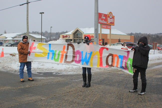 Protesters with the United Urban Warriors Society took to the highways 17 and 6 intersection during their protests on Feb. 13. Photo by Jessica Brousseau/The Mid-North Monitor/QMI Agency