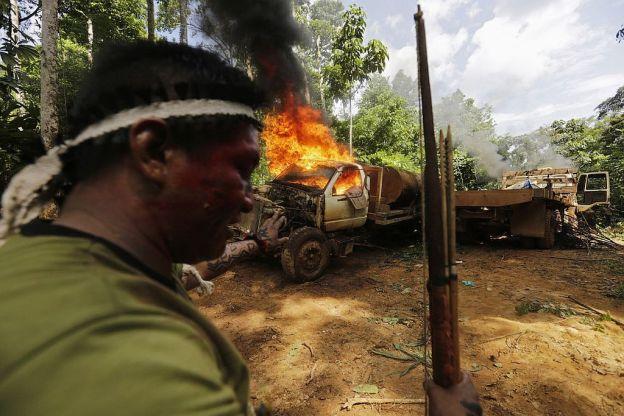 A logging truck is set on fire.