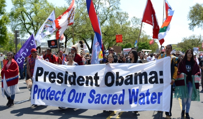 Native Americans march during an anti-Keystone XL protest in Washington on April 26, 2014. Credit:   Stephen Melkisethian