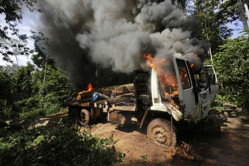A logging truck burns after it was discovered and set on fire by Ka'apor Indian warriors