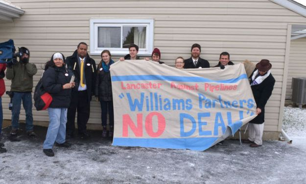 Eight gas  pipeline protesters hold a rally Thursday morning after they plead guilty to summary trespass for blocking a pipeline drilling crew near Safe Harbor in January.