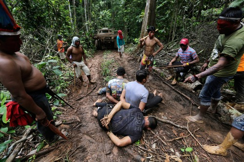 Ka'apor Indians tie up loggers during a jungle expedition in the Alto Turiacu Indian Territory.