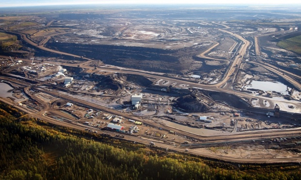 A tar sands mine facility near Fort McMurray, in Alberta.The memo presents continued expansion of oil and gas production as an inevitability. Photograph: Jeff McIntosh/AP