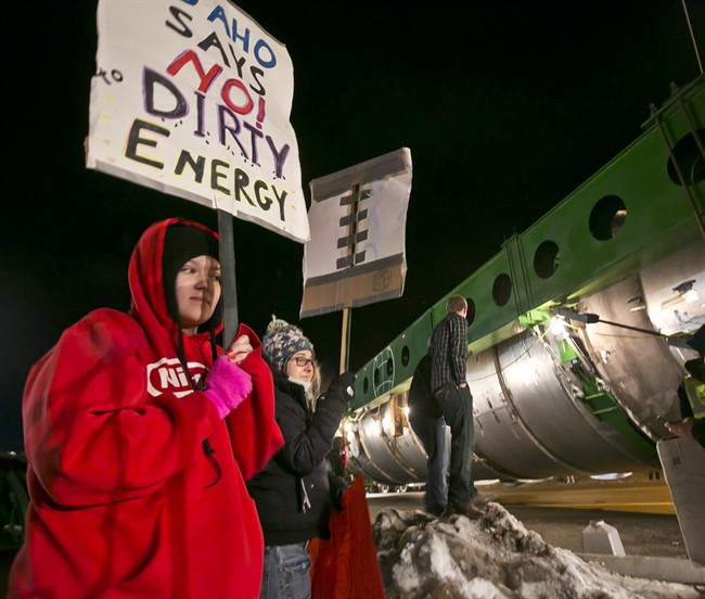 Megan Jeffs, 19, watches the controversial megaload move through Marsing, Idaho, on Dec. 28, 2013. Unexpected visitors have been dropping in on anti-oil activists in the United States ??? knocking on doors, calling, texting, contacting family members. The visitors are federal agents. THE CANADIAN PRESS/AP, The Idaho Statesman - Darin Oswald