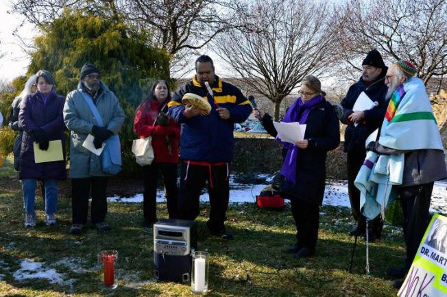 Chief Carlos Whitewolf of Lancaster sings a Native American prayer in protest of a pipeline project. The protest was outside a Republican Party retreat. (NATASHA KHAN, PUBLICSOURCE)
