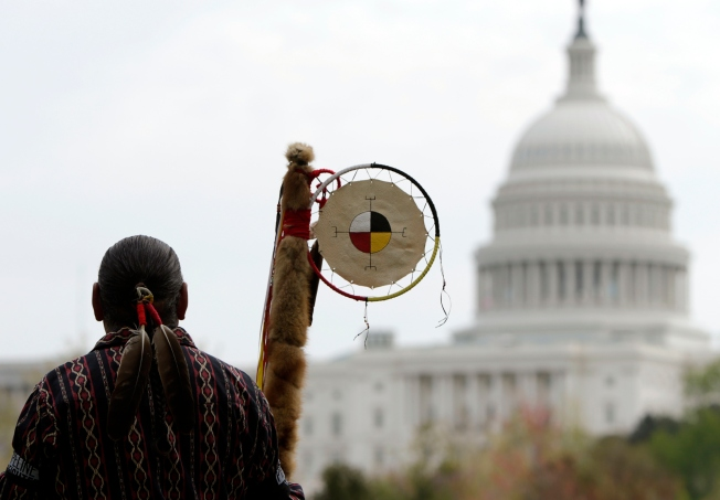 Matthew Black Eagle Man of the Sioux Long Plains First Nation of Manitoba protests in front of the U.S. Capitol, against the Keystone XL pipeline in April 2014. (Reuters/Gary Cameron)