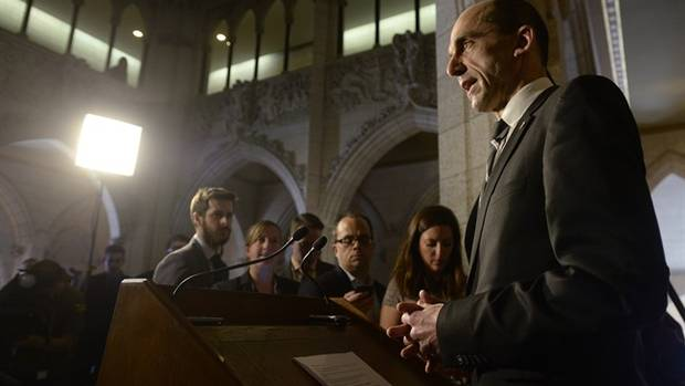 Public Safety Minister Steven Blaney comments on the arrest of a man plotting to blow up the U.S. consulate and buildings in Toronto's financial district, in the foyer outside the House of Commons in Ottawa, Wednesday, March 11, 2015. THE CANADIAN PRESS/Adrian Wyld
