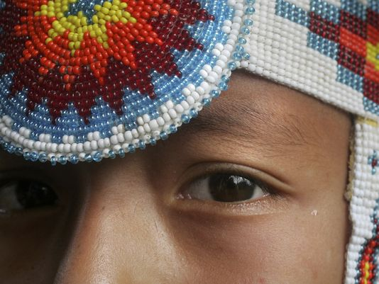 rake Keahna, 8, wears traditional clothing for a Meskwaki powwow in 2006. The tribe has voiced opposition to the proposed Bakken oil pipeline, which a Meskwaki official says would run through the tribe's aboriginal rights lands. (Photo: Register file photo)