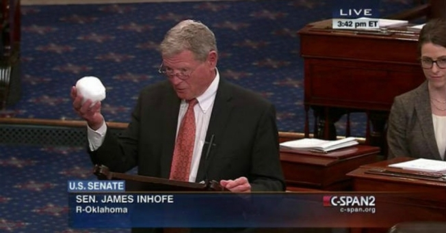 "Republican Senator James Inhofe, who chairs the Environment and Public Works Committee, brandished a snowball while giving a Senate speech about the ""hysteria on global warming"" on February 26. (Screenshot via C-SPAN)"